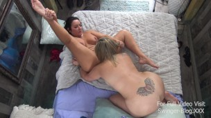 Busty lesbian MILFs licking and enjoying a strap on in exclusive amateur swinger video
