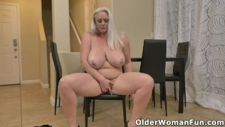 Busty BBW milf Cameron Skye enters the room in fishnet pantyhose and plays