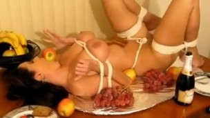 Girl tied like turkey and ball gagged on table cc