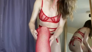 Trying on red lingerie with fishnet stockings